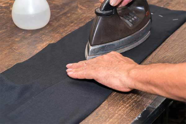 Carefully iron the legs of the pants